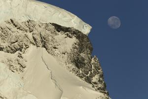 A Mountain Peak with an Icecap and a Nearly Full Moon by Tim Laman