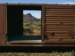 A View of a Distant Hill Through the Door of a Railway Car by Tim Laman