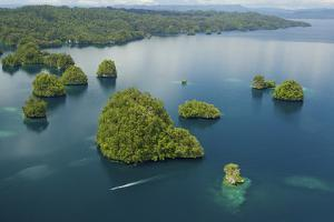 Limestone Islands of Kabui Bay Near the Passage Between Gam Island and Waigeo Island by Tim Laman