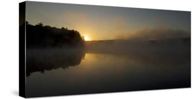 Mist at the Walden Pond at sunrise. by Tim Laman