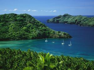 Sailboats Anchored in a Cove of Blue Water on Nuku Hiva Island by Tim Laman