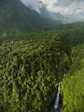 The Ole River meanders and falls through the Gran Caldera by Tim Laman