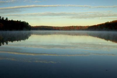 The sky reflects in Walden Pond. by Tim Laman