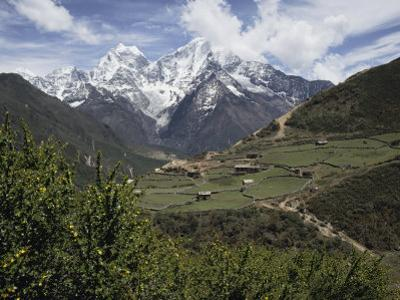 View of a Small Village with Mount Everest in the Background by Tim Laman