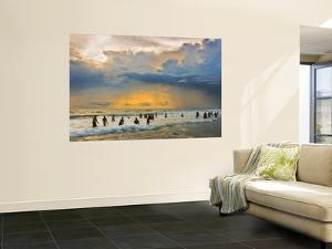 Indian Bathers Playing in Surf During Cloudy Sunset by Tim Makins