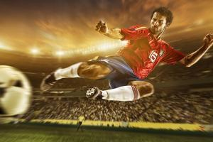 Soccer Player Mid-Air Kicking Ball, Brazil, South America by Tim Tadder