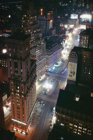 https://imgc.allpostersimages.com/img/posters/times-square-and-garment-district-at-night_u-L-PZP0RN0.jpg?p=0