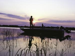 Man Standing in Boat Fishing by Timothy O'Keefe