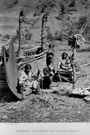 A Navajo Family Outside their Home
