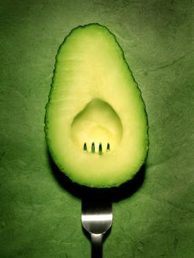 Half an Avocado with a Fork by Tina Chang