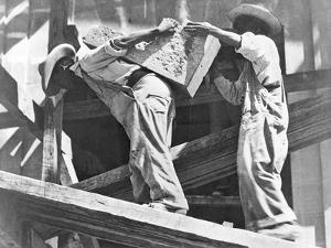 Construction Workers at the Stadium, Mexico City, 1927 by Tina Modotti