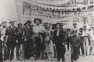 Diego Rivera and Frida Kahlo in the May Day Parade, Mexico City, 1st May 1929 by Tina Modotti