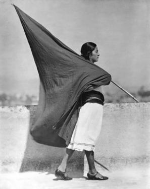Woman with Flag, Mexico City, 1928 by Tina Modotti