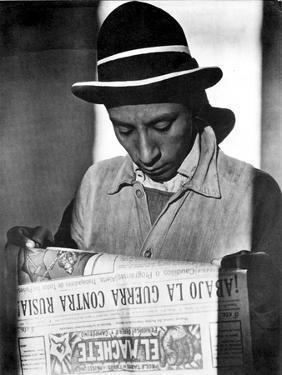 Worker Reading El Machete, Mexico City, 1925 by Tina Modotti
