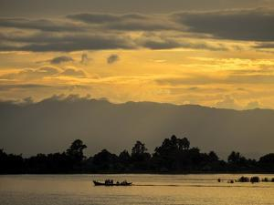 A Boat on the Irrawaddy River by Tino Soriano