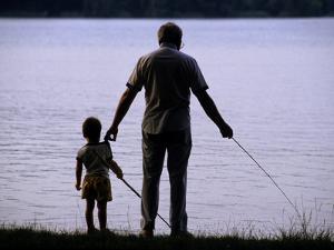 A Man and a Boy Fishing Along the Shore of Lake Banyoles by Tino Soriano