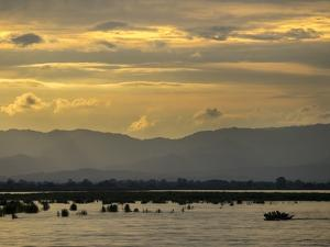 A View of Mountains Beyond the Irrawaddy River at Sunset by Tino Soriano