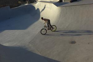 A Young Man Riding a Bike in a Skate Park in Gijon, Spain by Tino Soriano