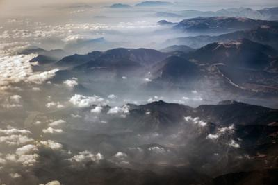 An aerial view of the Pyrenees between Spain and France after dawn. by Tino Soriano