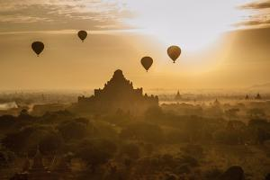 Balloons Above Stupas and Dhammayangyi Patho Temple from the Shwesandaw Pagoda by Tino Soriano