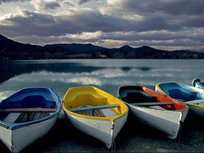 Boats on the Shore of Lake Banyoles at Sunset by Tino Soriano