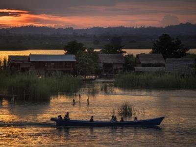 People in a Boat on the Irrawaddy River by Tino Soriano