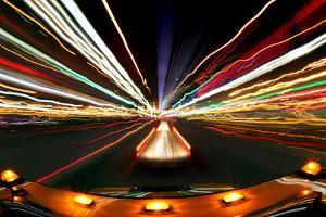 Intentional Blur Image of Driving at Night with City Lights And by tobkatrina