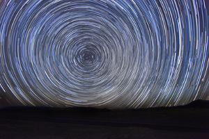 Long Exposure Time Lapse Image of the Night Stars by tobkatrina