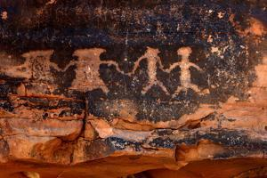 Native American Petroglyphs in Red Sandstone from the Southwestern Desert by tobkatrina