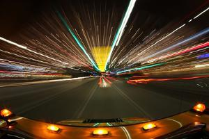 Speed Driving in Los Angeles with Bright City Lights by tobkatrina