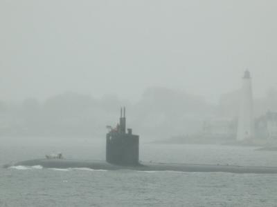 A Submarine Passes New London Harbor Light in the Fog