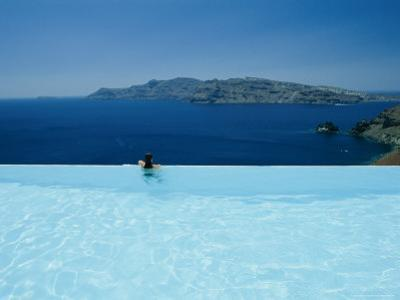 A Swimmer Enjoys the View from a Pool Overlooking the Aegean