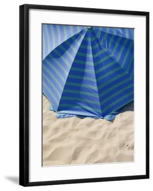 A view from above of a beach umbrella by Todd Gipstein