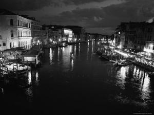 Black and White Photograph of Grand Canal From Rialto Bridge at Night by Todd Gipstein