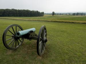 Civil War Cannon in Front of a Field at Gettysburg by Todd Gipstein