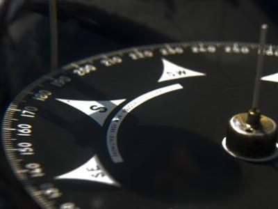 Close Up of a Compass on a Tall Ship by Todd Gipstein