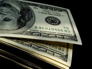 Close View of a Stack of One Hundred Dollar Bills by Todd Gipstein