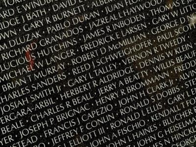 Close View of Names Carved in the Vietnam Veterans Memorial by Todd Gipstein