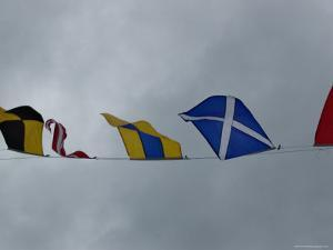 Close View of Nautical Flags Waving against a Cloudy Sky, Mystic, Connecticut by Todd Gipstein