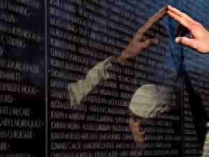 Hand Touches and is Reflected in the Vietnam Veterans Memorial by Todd Gipstein