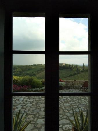 Looking Through a Window to the Rolling Hills of Tuscany, Italy