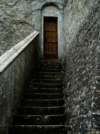 Narrow Stairway to a Wooden Door Inside the Grounds at Brolio Castle, Tuscany, Italy by Todd Gipstein