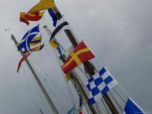 Nautical Flags Hanging from the Wooden Mast of a Sailing Ship, Mystic, Connecticut by Todd Gipstein