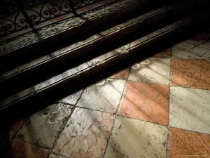 Shadows of an Iron Fence Fall on the Marble Floor of the Frari Church, Venice, Italy by Todd Gipstein