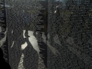 Shadows Reflected on the Wall of the Vietnam  Memorial by Todd Gipstein