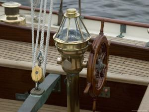 Ship's Wheel and Compass at the Helm of a Wooden Sailboat, Mystic, Connecticut by Todd Gipstein