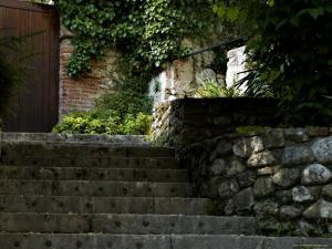 Stone Stairway Up to a Wooden Door, Asolo, Italy by Todd Gipstein