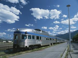 Via Rail Canada Train Waiting at Jasper Station with Rockies in Background by Todd Gipstein