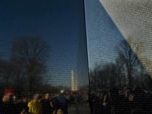 Visitors and Washington Monument Reflected in the Vietnam Memorial by Todd Gipstein