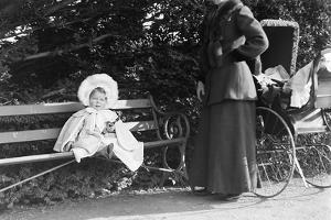 Toddler with Nanny or Mother on a Park Bench, Ca. 1900